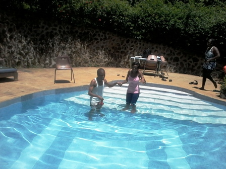 Picture of my friend Petty and me in Naiberi swimming pool. Petty fears water so I was trying to assist her get into the swimming pool. No big deal!