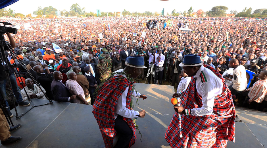 Raila and Odinga dancing in their campaign rally in Eldoret