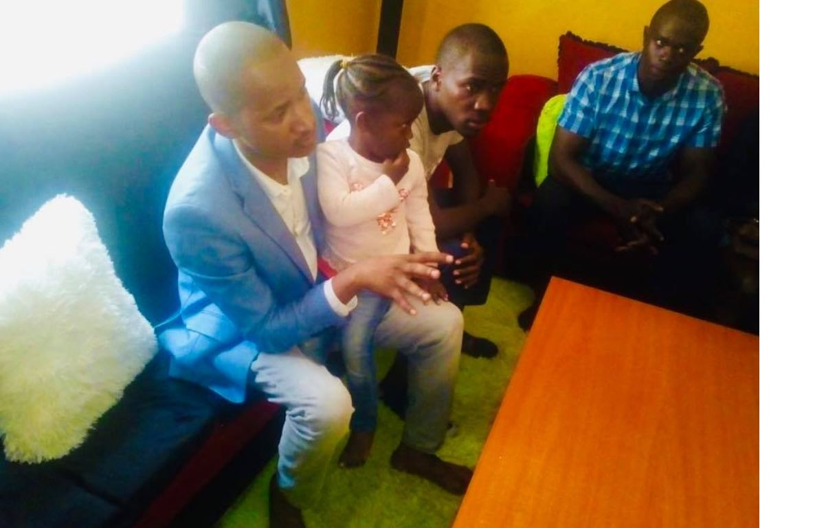 Babu Owino with the late OCS Ragira Samwel's daughter Talia when he visited his home