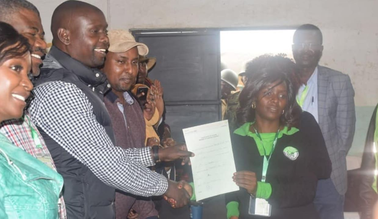 ODM candidate Imran Okoth receiving certificate from IEBC after being declared winner